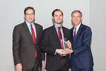 (L-R) Leidos Defense and Intelligence Group President, Tim Reardon, with Business Developer, Parker Hine, receiving the Rising Star award from Leidos Chairman of the Board & CEO, Roger Krone ...