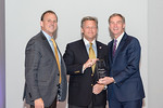 (L-R) Leidos Health Group President, Jon Scholl, and Jerry Hogge (accepting the award on behalf of Doug Barton) for Innovation in Science and Technology - Engineering, with Leidos Chairman o ...