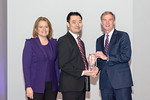 (L-R) Leidos Civil Group President, Angie Heise, and James Wei from the Saudi Aramco Security Operations Center (SOC) Team, accepting the award for  Excellence in Program Management - Small  ...