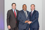 (L-R) Leidos Defense and Intelligence Group President, Tim Reardon, and David Ingram from the U.S. Army?s Ammunition Supply Point/Theater Storage Area (ASP/TSA) Team, accepting the award f ...