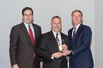 (L-R) Leidos Defense and Intelligence Group President, Tim Reardon, with Program Management Senior Manager, Kevin Massie, receiving the Individual Excellence award from Leidos Chairman of th ...