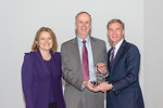 (L-R) Leidos Civil Group President, Angie Heise, and Russell Zub, from the FAA Alaska Weather Camera Program Team, accepting the award for Excellence in Program Performance - Technology Deve ...