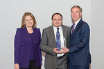 L-R) Leidos Civil Group President, Angie Heise, with Feras Karim, accepting the Thomas Edison Innovation award, with Leidos Chairman of the Board & CEO, Roger Krone at the Leidos Achievement ...