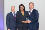 (L-R) Leidos Strategy and Business Development Vice President Gerry Fasano, and Norma Mitchell, accepting the Leidos Culture Champion award, with Leidos Chairman of the Board & CEO, Roger Kr ...