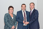 (L-R) Leidos Chief Administrative Officer, Mary Craft and Michael Flannigan, from the Sidewalk to Sky Campaign Team, accepting the award for Excellence in Marketing and Communication, with L ...