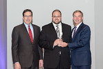 (L-R) Leidos Defense and Intelligence Group President, Tim Reardon, with Systems Engineer, Sebastian Lyons, receiving the Leadership Excellence award from Leidos Chairman of the Board & CEO, ...