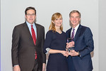 (L-R) Leidos Defense and Intelligence Group President, Tim Reardon, with Counterintelligence Analyst, Anna Franz, receiving the Rising Star award from Leidos Chairman of the Board & CEO, Rog ...