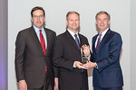 (L-R) Leidos Defense and Intelligence Group President, Tim Reardon, and Sam Gilson, from the Distributed Common Ground System-Navy (DCGS-N) Training Team, accepting the award for  Excellence ...