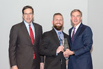 (L-R) Leidos Defense and Intelligence Group President, Tim Reardon, with Network Threat Support Specialist, Matthew Walker, receiving the Rising Star award from Leidos Chairman of the Board  ...