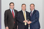 (L-R) Leidos Defense and Intelligence Group President, Tim Reardon, and David Coles, from the Joint Regional Security Stack (JRSS) Implementation Team, accepting the award for Excellence in  ...