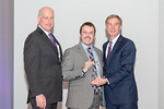 (L-R) Leidos Senior Vice President and Advanced Solutions Group President, Mike Chagnon, with Aaron Marshall, receiving the Rising Star award from Leidos Chairman of the Board & CEO, Roger K ...