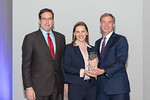 (L-R) Leidos Defense and Intelligence Group President, Tim Reardon, with Software Engineering Asc Manager, Jessica Kuchel, receiving the Leadership Excellence award from Leidos Chairman of t ...