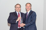 (L-R) Civil Engineer, Eric Van Brunt, receiving the Individual Excellence award from Leidos Chairman of the Board & CEO, Roger Krone at the Leidos Achievement Awards ceremony on January 31,  ...