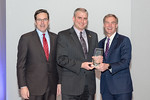(L-R) Leidos Defense and Intelligence Group President, Tim Reardon, with GIS Analyst, Marvin Treu, receiving the Individual Excellence award from Leidos Chairman of the Board & CEO, Roger Kr ...