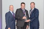 (L-R) Leidos Strategy and Business Development Vice President, Gerry Fasano, and Troy Woodruff from the SS AISR Capture Team, accepting the award for Excellence in Business Development - Cap ...