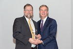 (L-R) Project Management & Operations Manager, Stephen Dunbar, receiving the Leadership Excellence award from Leidos Chairman of the Board & CEO, Roger Krone at the Leidos Achievement Awards ...