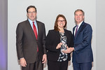 (L-R) Leidos Defense and Intelligence Group President, Tim Reardon, and Christina Hill, from the GSM-O Operations and Sustainment Task Order Team, accepting the award for Excellence in Progr ...