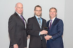 (L-R) Leidos Senior Vice President and Advanced Solutions Group President, Mike Chagnon, with Adam Schell, receiving the Individual Excellence award from Leidos Chairman of the Board & CEO,  ...