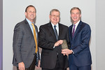(L-R) Leidos Health Group President, Jon Scholl, and Douglas Kuhns, from the Neutrophil Monitoring Lab Team accepting the award for Innovation in Science and Technology - Research & Developm ...