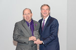 (L-R) Senior Facility Operations Analyst, Robert Piccinini, receiving the Rising Star award from Leidos Chairman of the Board & CEO, Roger Krone at the Leidos Achievement Awards ceremony on  ...