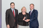 (L-R) Leidos Defense and Intelligence Group President, Tim Reardon, and Teresa Whitehead, from the Test and Acceptance (IT&A) Team, accepting the award for Excellence in Collaboration - Tech ...
