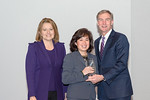 (L-R) Leidos Civil Group President, Angie Heise, and Anh Tran accepting the award for Excellence in Staff Development, with Leidos Chairman of the Board & CEO, Roger Krone at the Leidos Achi ...